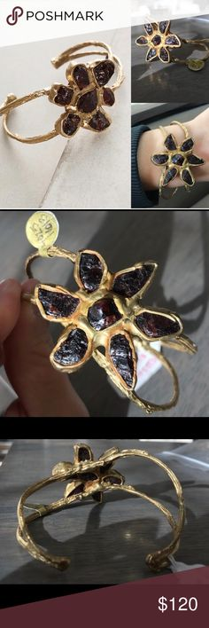 New Anthropologie Achimenes raw garnet flower cuff Nwt price crossed out to prevent store return Anthropologie Achimenes raw garnet flower cuff bracelet. Beautiful ✨ by Emilie Shapiro sold out at Anthropologie please NO low ball offers ✌️ Anthropologie Jewelry Bracelets