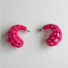3D printed joop earrings.Join the 3D Printing Conversation: http://www.fuelyourproductdesign.com/