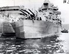 USS Minneapolis (CA-36). At Espiritu Santo, New Hebrides, in January 1943, after being fitted with a short temporary bow for the voyage back to the United States for permanent repairs. Minneapolis had been torpedoed by Japanese destroyers during the Battle of Tassafaronga, off Guadalcanal on 30 November 1942. Collection of Vice Admiral Homer N. Wallin, USN (Retired). NHHC Photograph Collection, NH 46013.