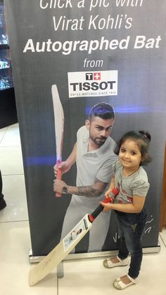 Youngest fan of Kohli with his autogarphed bat..!