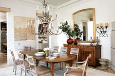 An 18th-century Italian chandelier makes agrand statement in the serene dining room.