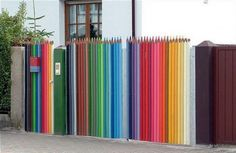 Make something fancy and interesting that will be a hallmark for you. Do unusual DIY fence for your yard. Use some old items such as skis or other ancient slats. You can also paint the old fence and create a rainbow of colors, or you can carved it in the form of some interesting figures.