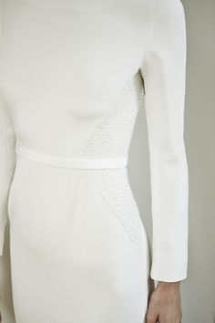 Charlotte Simpson modern wedding dress with long sleeves and embroidered waist and belt detail - minimal wedding gown
