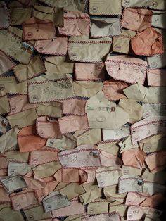 a wall of vintage envelopes