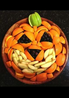 Jack O' Lantern Fruit Bowl Just like the veggie jack o' lantern tray, you can also do this with fruit. I love how this one is placed in a bo...