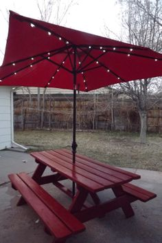 picnic table with umbrella and lights