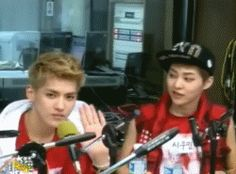 Kris is trying to flirt and Xiumin is just scolding Kris.ㅋㅋ <3