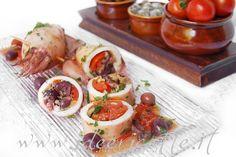 La ricetta deicalamari ripieni alla napoletana(imbuttunat significa ripieno, in dialetto napoletano) è una ricetta semplice ed estiva per cucinare i calamari che ha sempre cucinato la mia mamma, fin da quando ero piccola. Ovviamente per ottenere un risultato delizioso è importante avere ingredienti freschissimi e di qualità.. attenzione quindi a scegliere gli ingredienti con la massima cura e attenzione! Ingredienti calamari ripieni per 4 persone - 4 calamari freschissimi di medie…