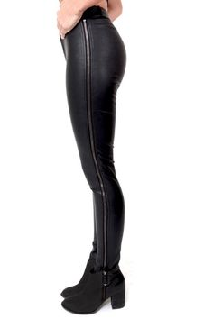 These vegan leather pants define sexy hugging every curve and featuring zippers that run from your waist to your ankle. - 55% Cotton, 45% P.U