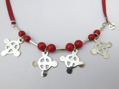 Andrea Osses. Red coral, leather and silver