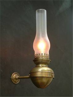 Dauphine brass antique french style wall light lighti g oil lamp style wall light with decorative arm aloadofball Images