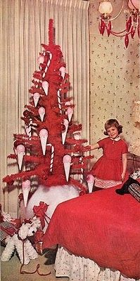 Oh, yes! Not only is her tree red (yes!), and covered in pink ice cream cones (YES!), it is apparently in her bedroom!!! AND bonus points for having ornaments hanging on the ceiling light too. You go, girlie!