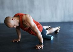 Pre-roll foam roller stretches for biking. Drop the foam roller on the floor—you're basically going to be lying on top of it and rolling yourself back and forth, using your hands for leverage and balance.