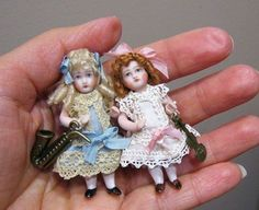Two little dolls ~~~ I'm so drawn to these tiny girls