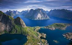 Panoramic view of Kjerkfjorden and the fishing village of Reine, on Moskenesøya island, part of the Lofoten Islands of northern Norway.