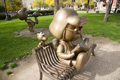 Bronze statues of Peanuts characters - Peppermint Patty, Woodstock and Marcie stand in Rice Park, in downtown St. Paul, Minnesota.