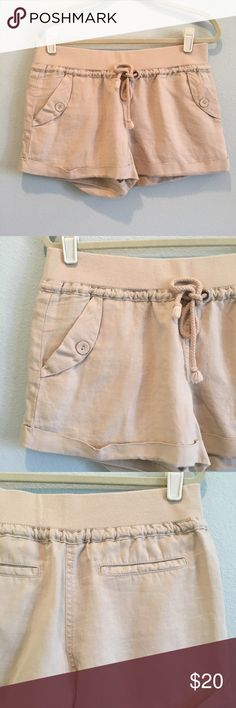 London Jean Light Brown Linen Shorts Excellent condition. No damage. Waist is an elastic band with a drawstring. Size medium. Inseam 3 inches. Body and your percent linen. Try am 95% cotton, 5% spandex. London Jean Shorts