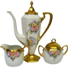 This fabulous Hand Painted Limoges Coffee Set will consist of a Footed Coffee Pot, One Creamer and one Covered Sugar Bowl.  They are all hand painted with lovely blooming pink and yellow roses and
