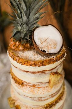 Tropical naked buttercream wedding cake with coconut flake and pineapple chunks. Pineapple Cake, Pineapple Coconut, Tropical Party, Tropical Decor, Tropical Interior, Tropical Desserts, Tropical Colors, Tropical Furniture, Wedding On A Budget