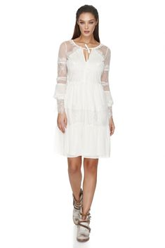 Get ready to stand out from the crowd in this Vero Milano ivory lace dress, featuring long sleeves and a flattering A-line tailoring.