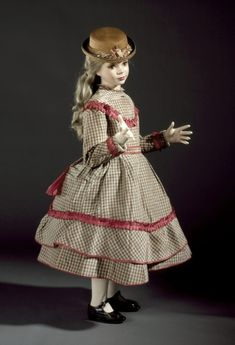 Girl's dress and overskirt, silk faillet trimmed with silk taffeta and lined with glazed cotton, c. 1869, English or American.