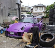 Purple 993 RWB Porsche... I have three questions, (1)Seriously?  (2)Parked out back with the junk?  (3)Really ?