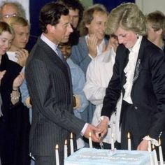 """""""Can,i help you darling?""""   SEPTEMBER 30 1986: Princess Diana And Prince Charles Cutting A Cake To Celebrate Ten Years Of The Prince's Trust Concert At Wembley."""