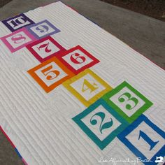 Love this for a backing idea. Hopscotch! Full pattern/instructions