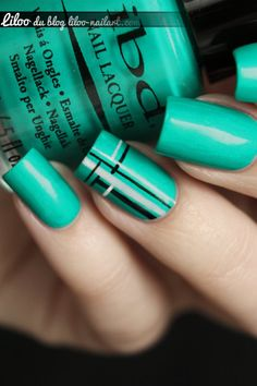 Teal nails with black and white graphic lines