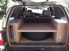 Have middle surface adjustable for height so as to accommodate larger tire/gear Jeep Xj Mods, Truck Mods, Truck Storage, Vehicle Storage, Drawer Storage, Jeep Wk, Jeep Grand Cherokee Zj, Hors Route, Convertible