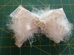 White Feather Barrette by MeridaMerchandise on Etsy, $12.00 SALE ON ALL BOWS at Merida Merchandise on Etsy. https://www.etsy.com/shop/MeridaMerchandise?section_id=13878367