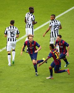 Ivan Rakitic of Barcelona celebrates scoring the opening goal with team mates during the UEFA Champions League Final between Juventus and FC Barcelona at Olympiastadion on June 6, 2015 in Berlin, Germany @fashionreality