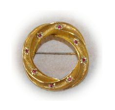 Gold Circle Brooch with Clear and Ruby Crystals by bettysworld4u