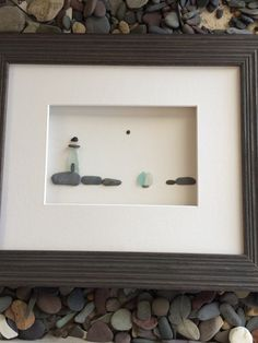 Light house and sea glass sail boat by pebble art by by PebbleArt