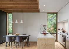 Inside the dwelling, the ground level contains a mudroom, a kitchen and an open-plan living and dining area.