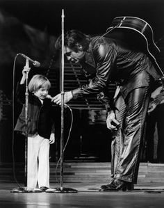 Johnny Cash and his son, John on stage