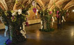 "During Fleuramour 2015 in Alden Biesen the floral designer David Vasquez was asked to create a floral design work in the ""Basement"" of the Castle of Alden Biesen. With little materials he transformed the basement in a tropic forrest."
