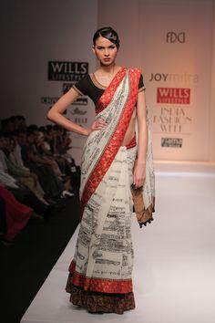 White, black and red saree