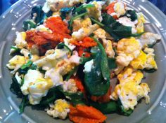 EGG SCRAMBLE:  3 eggs scrambled, green onion chopped, spinach leaves, chunks of cooked sweet potato.