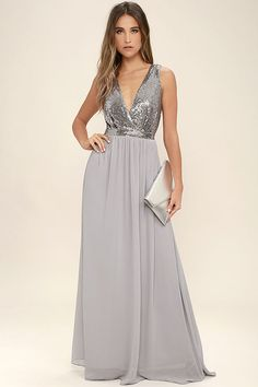 The Elegant Encounter Pewter Sequin Maxi Dress was made for fairy tale endings! A sleeveless sequin bodice with no-slip strips, and plunging V-neckline, is met by a fitted waist, and full woven maxi skirt. Hidden back zipper/clasp.
