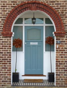 Lovely front door with arched brick entry and front porch. Teal green or blue front door. Front Door Porch, Front Door Entrance, House Front Door, Front Door Colors, Front Entrances, Entry Doors, Front Doors, Entrance Halls, Doorway