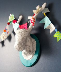 My Boat Floats used the lilblueboo.com paper mache animal head tutorial to make this awesome piece of decor!