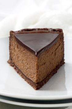 Luscious and creamy, this Chocolate Espresso Cheesecake is chocolate heaven - rich chocolate cheesecake with the perfect hint of espresso to deepen and balance the flavor, a pecan and chocolate cookie crust, and topped with chocolate ganache.