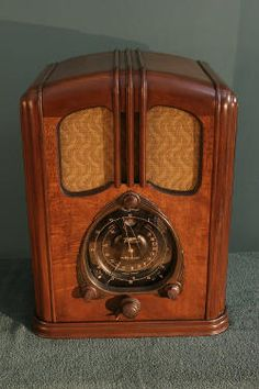 old Zenith radio - don't remember what kind we had but it was big and sat on the floor and I sat right next to it to listen. The Shadow lol. Molly ??