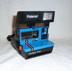 Polaroid OneStep 600 Red Stripe with Close Up Lens - Works Great, Upcycled Blue by UpcycledClassics on Etsy https://www.etsy.com/listing/222728125/polaroid-onestep-600-red-stripe-with