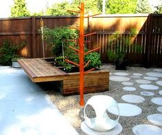 raised garden with bench and the towel tree.
