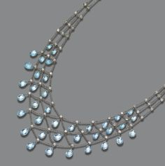 PLATINUM, AQUAMARINE BRIOLETTE AND DIAMOND NECKLACE.  The delicate lattice chain supporting 36 briolette aquamarine drops and set with 79 small old European-cut diamonds weighing approximately 4.00 carats, length 17 inches.