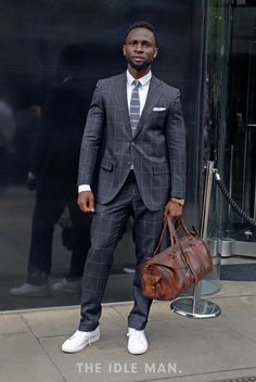 Men's Street Style | Sporty Dapper - Grab yourself a cool well fitted suit and ditch the smart shoes for a trendy pair of trainers. | Shop the look at The Idle Man