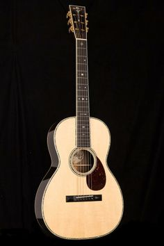 """Collings 042 BR A 12-Fret #21534. 24 7/8"""" scale length and elongated 12-fret body produce rich tone and volume that belie the guitar's small size. With old-growth Brazilian rosewood, Adirondack top, 42-style appointments."""