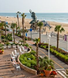 Virginia Beach boardwalk in front of the Hilton Hotel with King Neptune statue in background....
